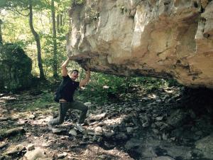 rafael-holding-up-a-boulder
